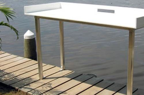 fiberglass fish table on wahoo aluminum dock with ipe wrapped poles and ipe dock decking