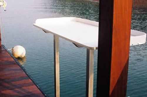fish table on wahoo aluminum dock with ipe wrapped poles and ipe dock decking